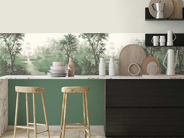 A kitchen with high stools, a green painted wall, and a matching green wallpaper border - Woodchip & Magnolia - Goodhomesmagazine.com