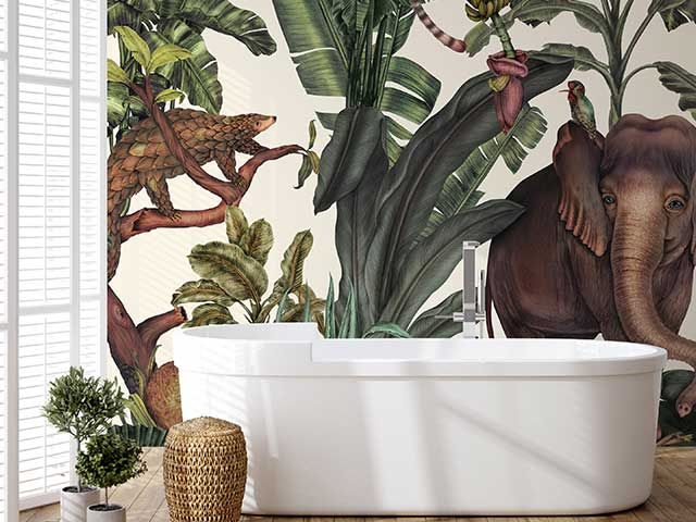 A bathroom with a vivid jungle print mural featuring a large elephant on the wall - Instagram wallpaper trends - Goodhomesmagazine.com