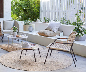 Best outdoor rugs: Scandi patio furniture with round jute rug from John Lewis
