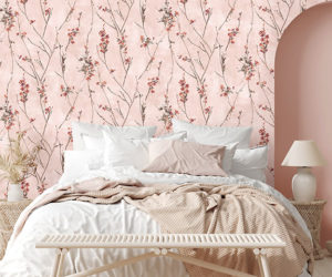 Pink floral decor wallpaper in bedroom with messy bed and archway