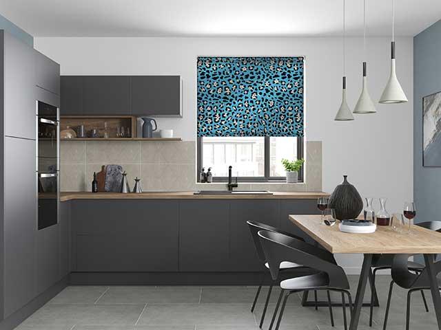 Blue animal print roller blind in grey kitchen diner space