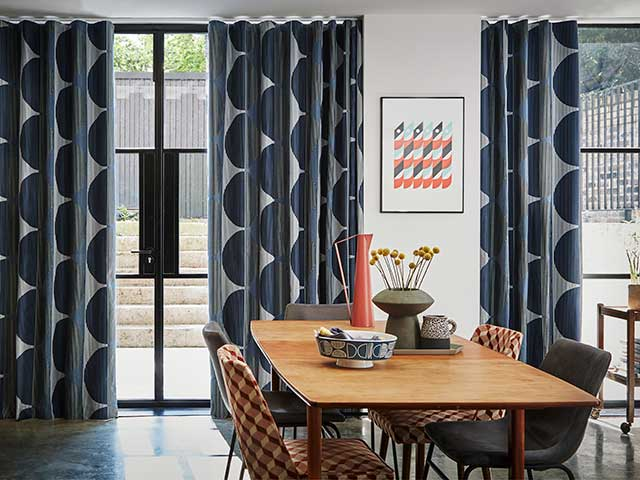 Margo Selby x Hillarys navy patterned full length curtains in dining room